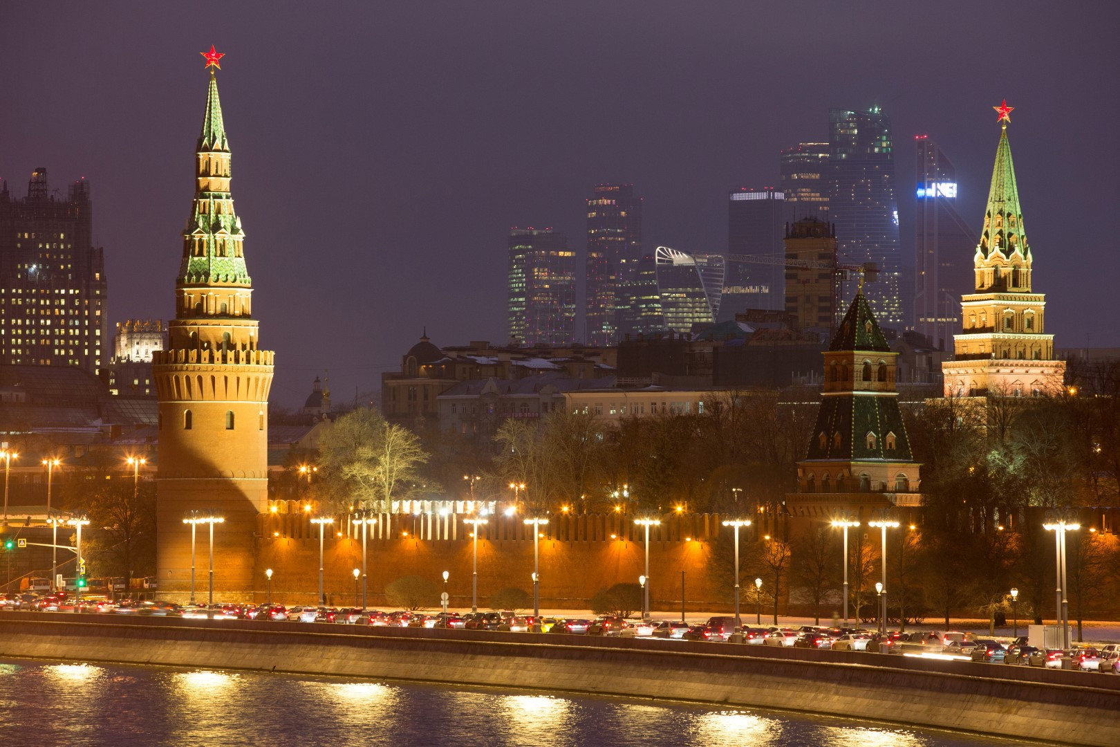 Skycrapers of the Moscow International Business Center, known as Moscow City, right, stand beyond the illuminated buildings of the Kremlin palace in Moscow, Russia, on Wednesday, Nov. 9, 2016. Russia is realistic about limits on the prospects for an immediate improvement in relations with the U.S. after President-elect Donald Trump takes office, according to President Vladimir Putin's spokesman. Photographer: Andrey Rudakov/Bloomberg