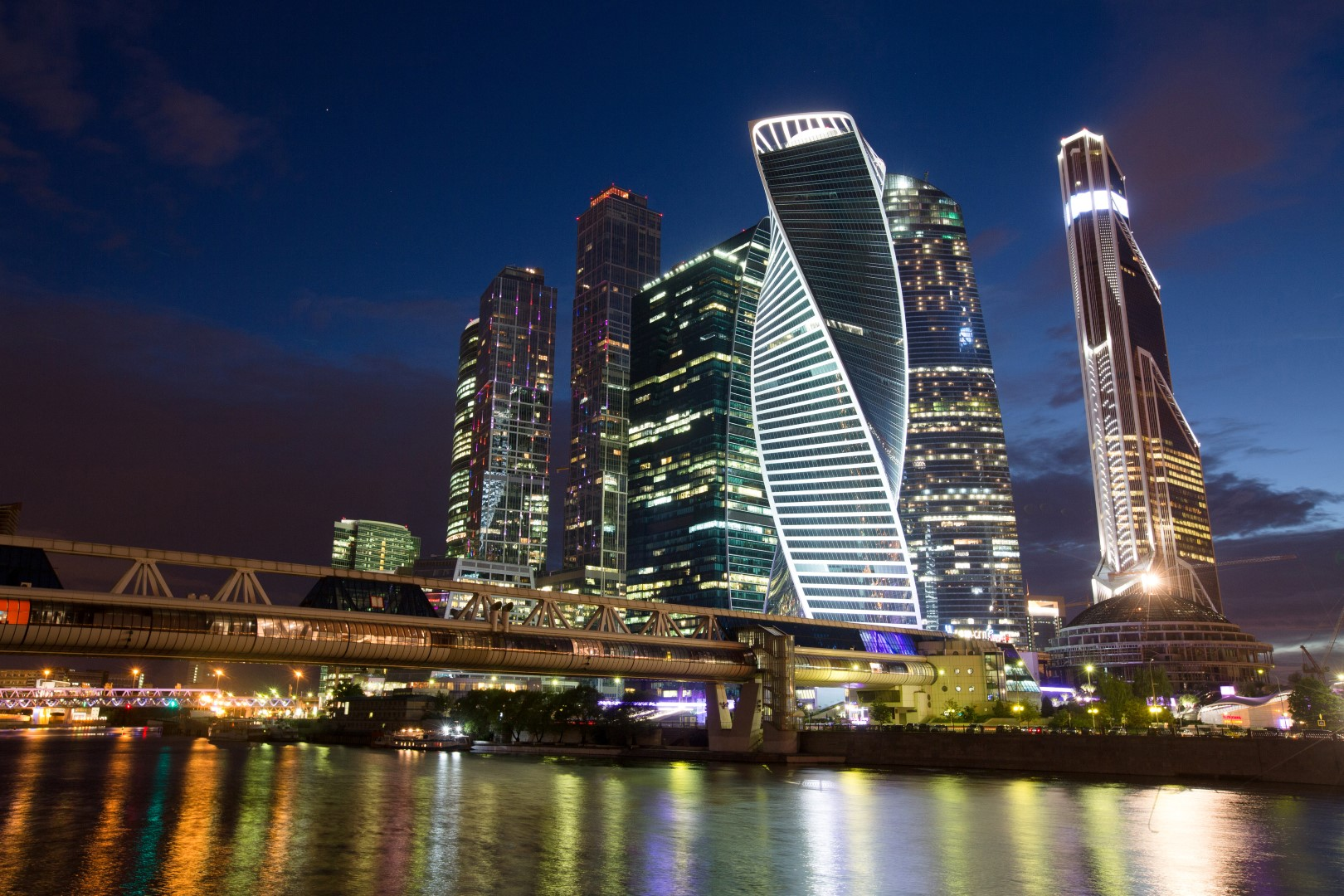 Lights illuminate commercial office skyscrapers at the Moscow International Business Center (MIBC), also known as Moscow City, on the River Moskva in Moscow, Russia, on Tuesday, Aug. 16, 2016. Despite an economic contraction since the start of 2015, unemployment has now dropped for three straight months to near the lowest in a year. Photographer: Andrey Rudakov/Bloomberg