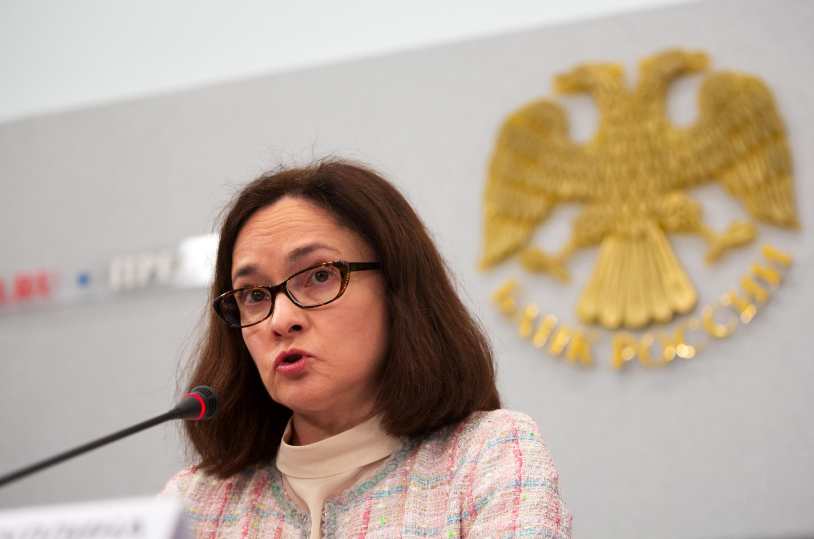 Elvira Nabiullina, governor of Russia's central bank, speaks during a rate decision news conference in Moscow, Russia, on Friday, March 13, 2015. Russia's central bank lowered its main interest rate in line with most economist forecasts, as stabilizing inflation clears the path to boosting an economy buckling under low oil prices and sanctions over Ukraine. Photographer: Andrey Rudakov/Bloomberg *** Local Caption *** Elvira Nabiullina