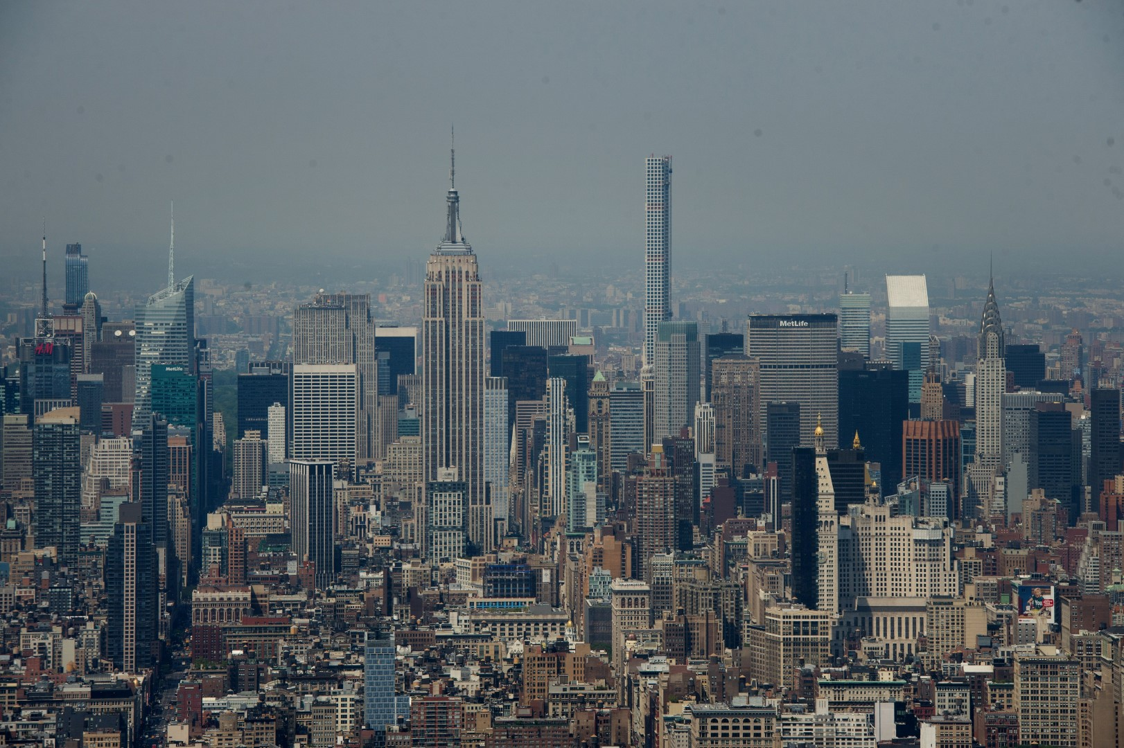The Empire State, left, and Chrslyer buildings standing in the Manhattan skyline are seen from One World Observatory at One World Trade Center in New York, U.S., on Tuesday, May 26, 2015. One World Observatory, the viewing deck at Manhattan's 1 World Trade Center, opens Friday, giving tourists New York vistas that were lost on 9/11 and helping cover the cost of the most expensive building ever. Photographer: Craig Warga/Bloomberg