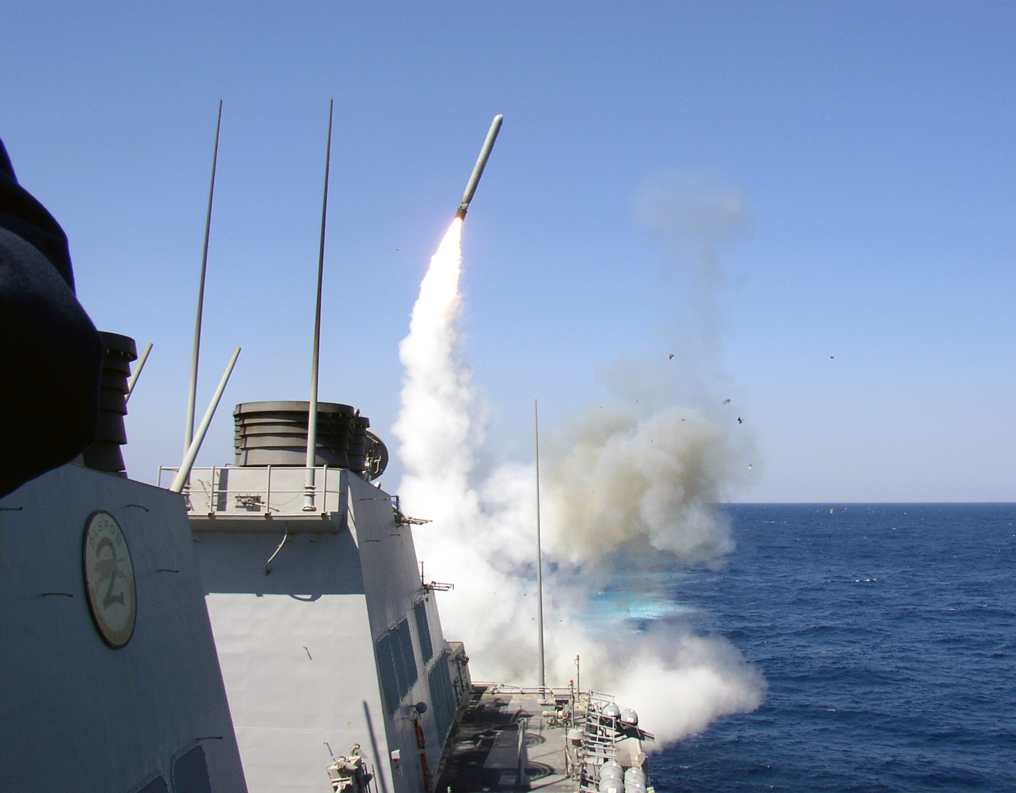 The guided missile destroyer USS Porter (DDG 78) launches a Tomahawk Land Attack Missile (TLAM) toward Iraq on March 22, 2003. Porter is deployed by the U.S. in support of Operation Iraqi Freedom. Large explosions rocked Baghdad late on March 25, briefly halting Iraqi television broadcasts as the first blast struck the capital. REUTERS/Lt. Christopher Senenko/U.S. Navy NVNS/GN - RTRKUDI