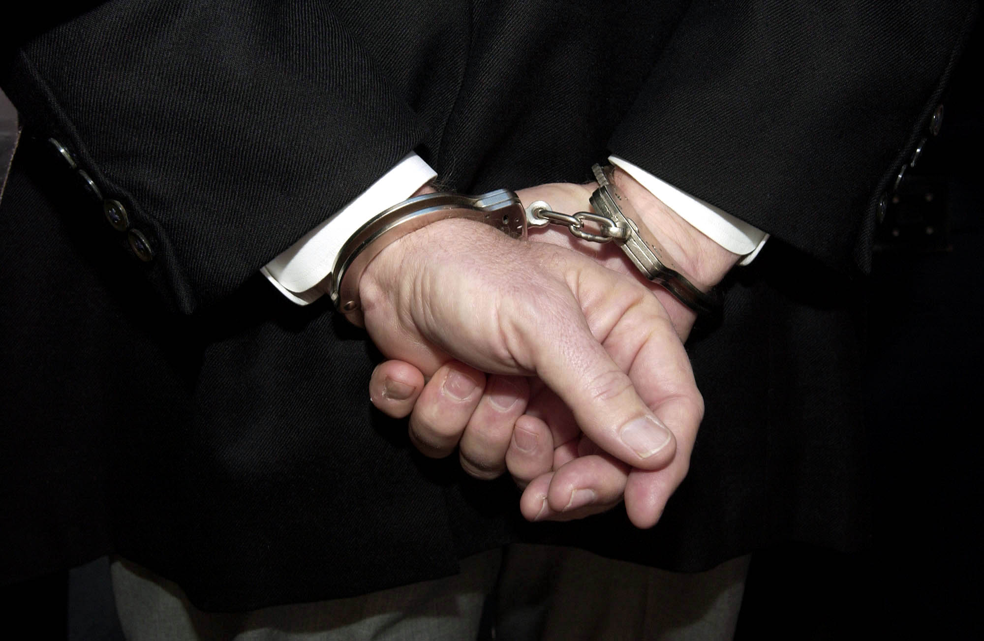 Former Worldcom CEO Bernard Ebbers, is escorted in handcuffs from the U.S. Federal Bureau of Investigation where he turned himself in this morning in New York, March 3, 2004.  He was indicted yesterday for allegedly masterminding the biggest accounting fraud in US history.  Photographer:  Daniel Acker/ Bloomberg News.