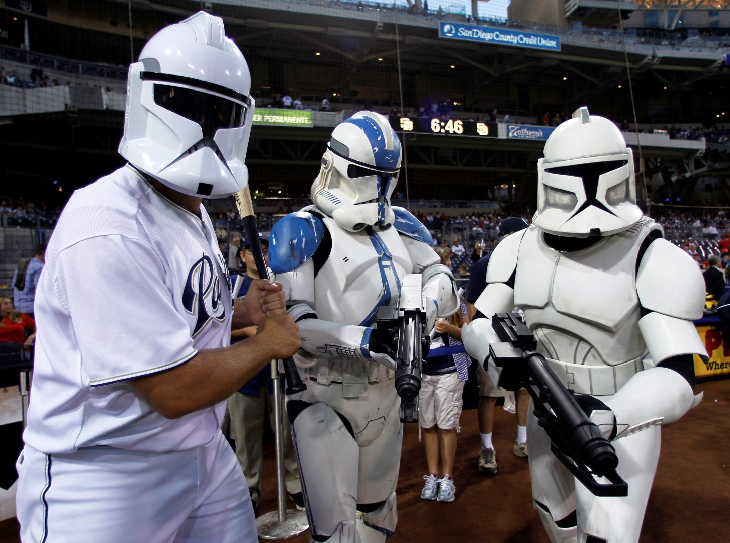 San Diego Padres relief pitcher Heath Bell (L) jokes around with Star Wars clone troopers during Star Wars night at the ball park prior to playing the Cincinnati Reds in their National League baseball game at Petco Park in San Diego, California September 24, 2010.   REUTERS/Mike Blake   (UNITED STATES - Tags: SPORT BASEBALL ENTERTAINMENT) - RTXSMJQ