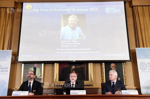 Photo of Richard H. Thaler is displayed on the screen during the announcement of the winner of the Nobel Prize in economic sciences 2017, in Stockholm