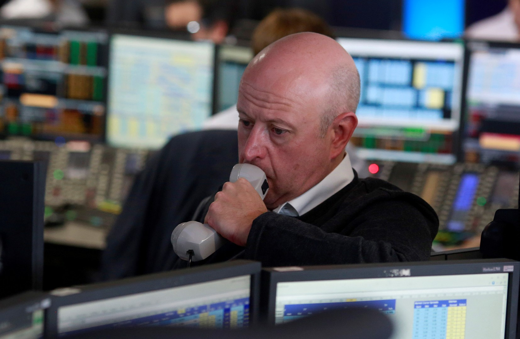 A trader from BGC Partners, a global brokerage company in London's Canary Wharf financial centre waits for European stock markets to open