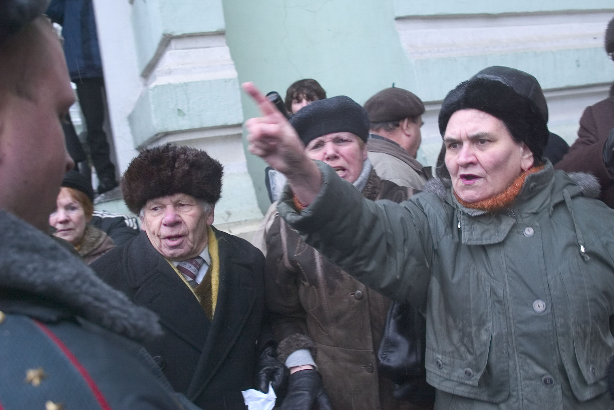 Protesters argue with police at a demonstration in Moscow  Russia, Saturday, January 22, 2005. Russian pensioners have blocked roads and main streets in the country's biggest cities to protest the abolition of free public transportation and prescription drugs in exchange for cash compensation. Photographer: Dmitry Beliakov/Bloomberg News.