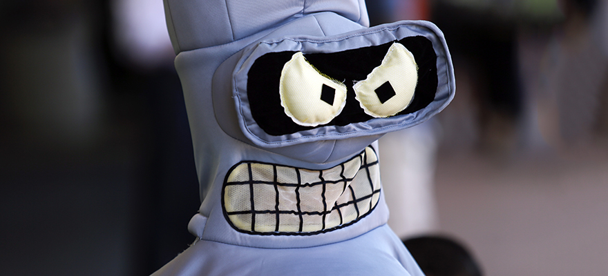 An attendee dressed in a costume of Bender from the Futurama cartoon show attends the Comic-Con International convention in San Diego, California, U.S., on Thursday, July 9, 2015. Comic-Con International is a nonprofit educational corporation dedicated to creating awareness of comics and related popular art forms. Photographer: Patrick T. Fallon/Bloomberg