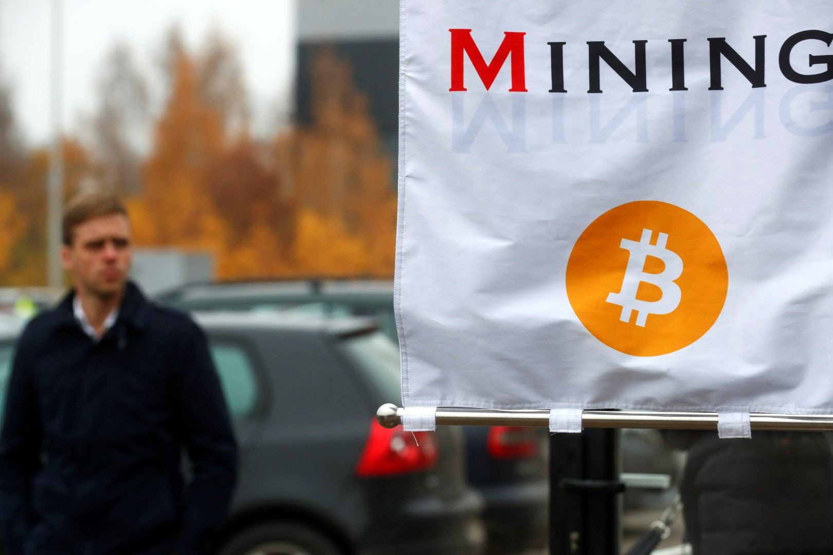 A man walks past bitcoin mininig show booth during Riga Comm 2017, a business technology and innovation fair in Riga, Latvia November 9, 2017. REUTERS/Ints Kalnins - RC1389CD3A20