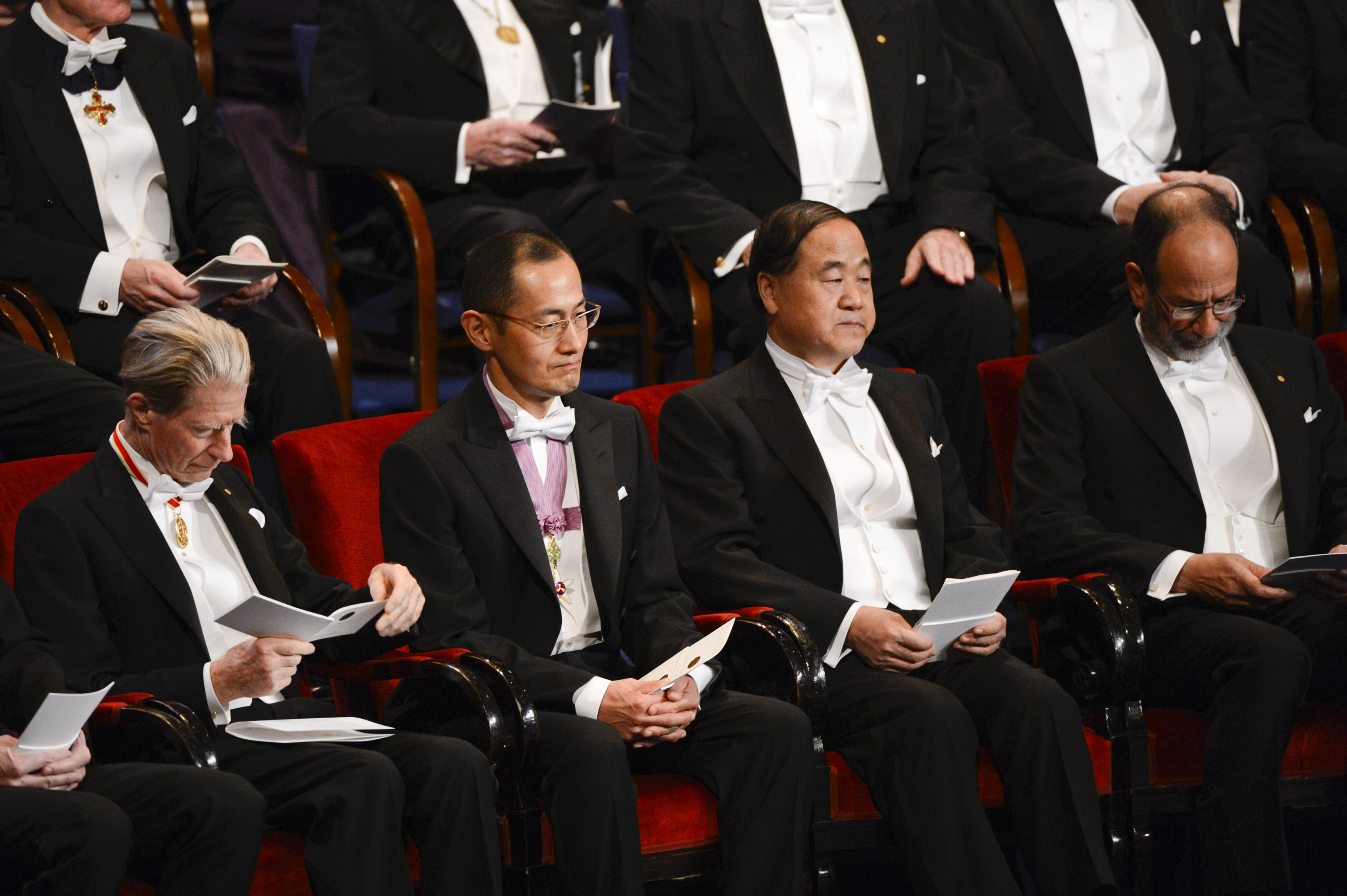 Laureates of the 2012 Nobel Prize for Physiology or Medicine John B. Gurdon (L) of Britain and Shinya Yamanaka of Japan (2nd L) sit with winner of the 2012 Nobel Prize for Literature Mo Yan (2nd R) of China and joint laureate for the 2012 Nobel Prize for Economics Alvin Roth of the U.S. during the Nobel Prize award ceremony at the Stockholm Concert Hall in Stockholm December 10, 2012. REUTERS/Henrik Montgomery/Scanpix (SWEDEN - Tags: SOCIETY) THIS IMAGE HAS BEEN SUPPLIED BY A THIRD PARTY. IT IS DISTRIBUTED, EXACTLY AS RECEIVED BY REUTERS, AS A SERVICE TO CLIENTS. SWEDEN OUT. NO COMMERCIAL OR EDITORIAL SALES IN SWEDEN. NO COMMERCIAL SALES - GM1E8CB00FS01