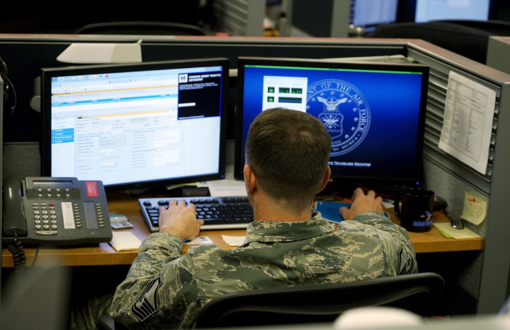 A U.S. Air Force airman works at the 561st Network Operations Squadron (NOS) at Petersen Air Force Base in Colorado Springs, Colorado July 20, 2015.  The 561st NOS executes defensive cyber operations in response to U.S. Cyber Command orders and intelligence based threats.    REUTERS/Rick Wilking - GF10000165291